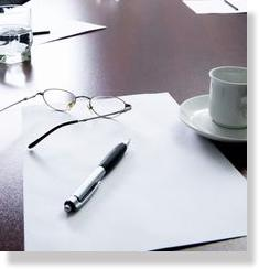 pen and glasses on table